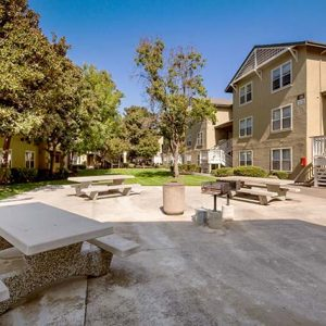 Community picnic area and apartment buildings
